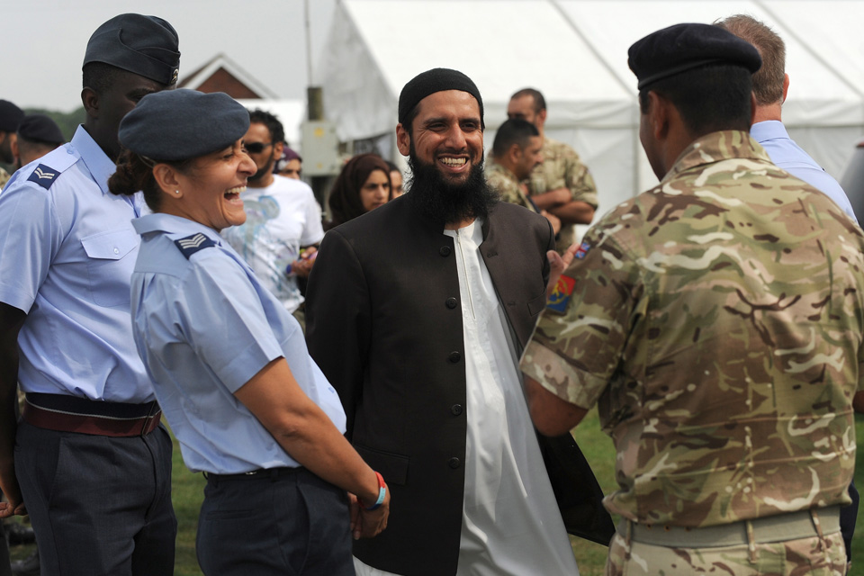 Members of the Armed Forces are joining the British Muslim community at their 2014 Living Islam Festival.  Representatives from the Royal Navy, Army and Royal Air Force have been invited to attend by the Islamic Society of Britain. The only national event of its kind, Muslims from across Britain and beyond will attend the four-day religious festival (31st July – 3rd August) at the Lincolnshire Showground.  Front-line men and women of the Armed Forces including soldiers, sailors and air personnel of the Armed Forces Muslim Association will deliver a multi-media presentation about their roles, which include providing humanitarian aid and disaster relief in the wake of a natural disaster and protecting UK citizens at home and abroad.   Members of the Armed Forces Muslim Association joined by Imam Asim Hafiz, Islamic adviser to the Ministry of Defence, will also take questions from the audience about the life of a Muslim in the Armed Forces.  Over 5,000 people are expected to attend the festival, with the presentations repeated on a daily basis. Friday's Question and Answer session was hosted by Major General Robert Nitsch and questions on behalf of the Army were answered by Brigadier Mark Abraham. Air Commodore Alan Opie spoke on behalf of the RAF and Commodore Jim Lines on behalf of the Royal Navy.  Image by Sgt Paul Morrison RLC - 01/08/2014 MoD Release Authorised Handout Image   IMAGE: Members of the Armed Forces Muslim Association share a joke with Imam Asim Hafiz (centre), Islamic adviser to the Ministry of Defence. (Female Left, Sergeant Wazeeha Laher, 42 RAF)  NOTE TO DESKS: MoD release authorised handout images. All images remain Crown Copyright. PHOTO CAPTION TO READ - Sgt Paul Morrison Army Photographer Email: paulmorrison@mediaops.army.mod.uk richardwatt@mediaops.army.mod.uk shanewilkinson@mediaops.army.mod.uk  Paul Morrison - 07846 716 171  PIC ED: Richard Watt - 07836 515306  DEP PIC ED: Shane Wilkinson 07901 590723